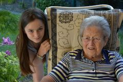 Me and grandma, girl surprises her great-grandma. Young and old, granddaughter with her  ninety years old great- grandmother Stock Photos