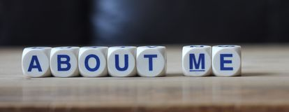 About me. Letters cube wordings on wood table royalty free stock photo