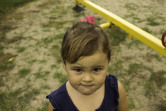 ME. Little girl looks up at camera with a quirky look Royalty Free Stock Photos