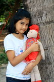 Me and my beautiful red doll. A small Indian girl with her favorite red doll Stock Photo