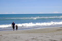Me & My Dad at the beach. Father & son walking along Opotiki Beach New Zealand Stock Photos