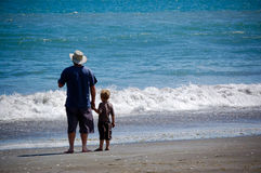 Me & My Dad standing by waters edge Royalty Free Stock Image