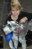 Me and my dog. Little girl and Schnauzer Stock Image