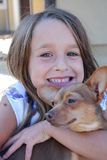 Me and my doggie. Littel girl holding a brown chiwawa Royalty Free Stock Photography