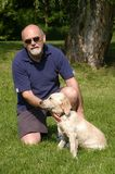 Me and my puppy che. Playing with my golden retriever in the park royalty free stock photos