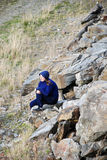Me and my thougts. Thoughtful girl sitting on a rock Stock Photo