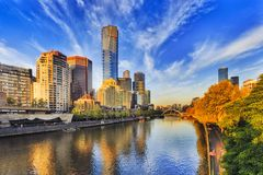 Me S Yarra Eureka Morning. Tallest Melbourne skyscraper Eureka tower dominates South Yarra cityscape over Yarra river in warm morning sunlight under blue sky Royalty Free Stock Image