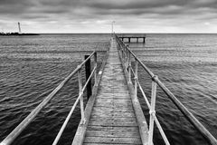Me St Kilda Boardwalk up away. Melbourne St Kilda beach's wooden boardwalk towards open sea at sunset in black-white variant. No colour version, only BW Royalty Free Stock Photos