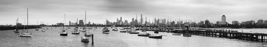 Me St Kilda Marina Jetty BW pan. St Kilda marina enclosed in calm harbour on Port Phillip bay in Melbourne, Victoria, with lots of yachts and sailboats moored in Stock Photography