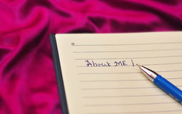 About me text on notebook. Pen on paper and about me text. Can be used in personal websites or biodata Stock Images
