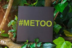 Me Too hashtag on black card , anti sexual harassment social media campaign. Me Too hashtag on black card  on tree, anti sexual harassment social media campaign Royalty Free Stock Photos