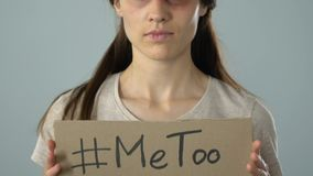 Me too hashtag poster in bruised woman hands, sexual assault victim asking help. Stock footage stock footage
