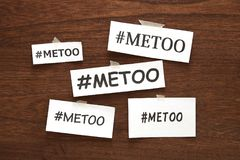Me Too Hashtag Word On White Papers On Wood. Me Too Social Movement Hashtag Against Sexual Assault And Harassment. Royalty Free Stock Photography