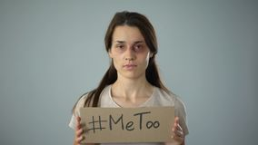 Me too sign in bruised woman hands, fight against sexual assault and harassment. Stock footage stock footage
