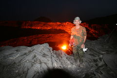Me and the volcano. Self portrait of the photograper in front of the Erta Ale lava lake stock photography