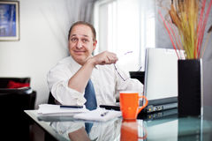 Me working at home. 45-50 year old man at home in front of the computer, smiling stock photo