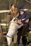 Me, You and the Dog. A mother her young son and the family dog out in an English country garden stock photography