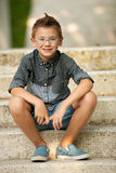 Me young boy sitting on stairs in park Royalty Free Stock Photo