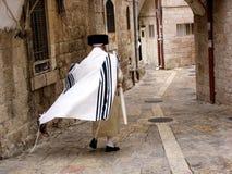Mea Shearim neighbourhood in Jerusalem Israel. JERUSALEM - OCT 20:Orthodox Jewish man walks in Mea Shearim on October 20 2005 Jerusalem, Israel.It's one of the Stock Photos