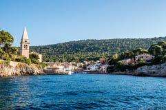 Meaditteraneam port with a church. Veli Losinj, Croatia Stock Photos