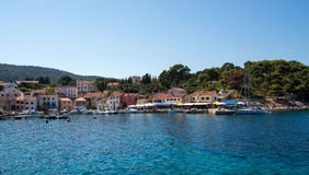 Meaditteraneam port. Entrance into Mediterranean port with houses and pine trees in the back Stock Photography