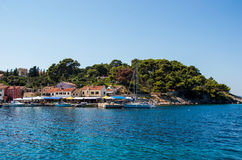 Meaditteraneam port. Entrance into Mediterranean port with pine trees on a hill Stock Photography