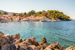 Meaditteraneam port. Entrance into Mediterranean port with rocky shore in front Stock Photography
