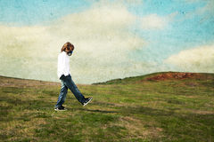 Meadow. A boy wearing a gas mask walking in the meadow royalty free stock photo