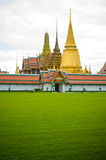 Meadow and anceint architecture in Buddism temple Royalty Free Stock Image