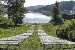 Meadow with benches Stock Photo