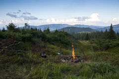 Meadow with a bonfire in the Carpathian mountains Royalty Free Stock Image