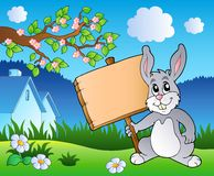 Meadow with bunny holding board Stock Photos