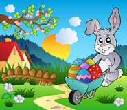 Meadow with bunny and wheelbarrow Royalty Free Stock Images