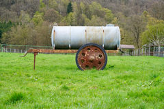 Meadow with a cattle watering tank Stock Photos
