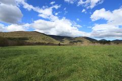 Meadow and cloudy sky in Pyrennes. Royalty Free Stock Photography
