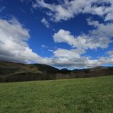 Meadow and cloudy sky in Pyrennes. Royalty Free Stock Photo