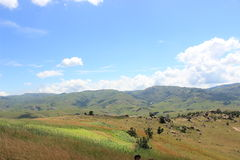 Meadow and cloudy sky by Sibebe rock, southern africa, swaziland, african nature, travel, landscape Royalty Free Stock Photo