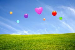 Meadow with colorful balloons Stock Photo