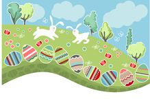 Meadow with easter eggs and rabbits Stock Photography