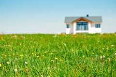 Meadow and Family House Stock Image