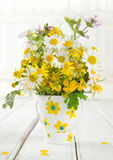 Meadow flowers. Bouquet of meadow flowers in a decorative vase royalty free stock photography