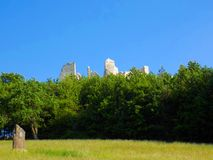 Meadow, forest and castle ruins Royalty Free Stock Photos