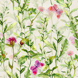 Meadow grass, herb, flowers with butterflies. Watercolor repeating pattern. Spring meadow: grass, herb and flowers with butterflies. Watercolor repeating pattern Royalty Free Stock Photos