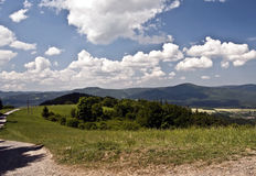 Meadow with hiking trail and panorama of Beskydy mountains Royalty Free Stock Image