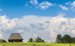 Meadow and House Stock Image