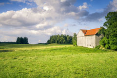 Meadow with a hut Stock Photos
