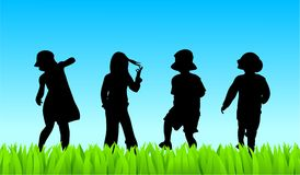 Meadow kids. Silhouettes of young children walking out in a field Royalty Free Stock Photos