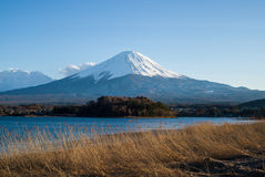 Meadow Lake and Mount Fuji. Meadow with lake and volcano Fuji on bright sky Stock Photo