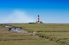 Meadow landscape with lighthouse Stock Photo