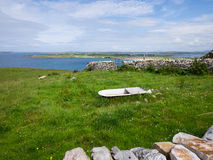 Meadow near the sea at Maghery, Donegal. Meadow with bathtub for the cows and view over the coast at Maghery, Donegal Royalty Free Stock Image